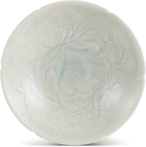 A large carved Qingbai 'peony' bowl, Northern Song dynasty