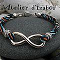 J'ai mal à la tête à l'infini comme ce bracelet en cordon liberty graphique couleurs ciel, orange, noir et blanc, bordé de perle