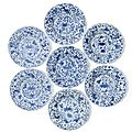 A set of seven blue and white fluted 'Sea creatures' dishes, Kangxi period (1662-1722)