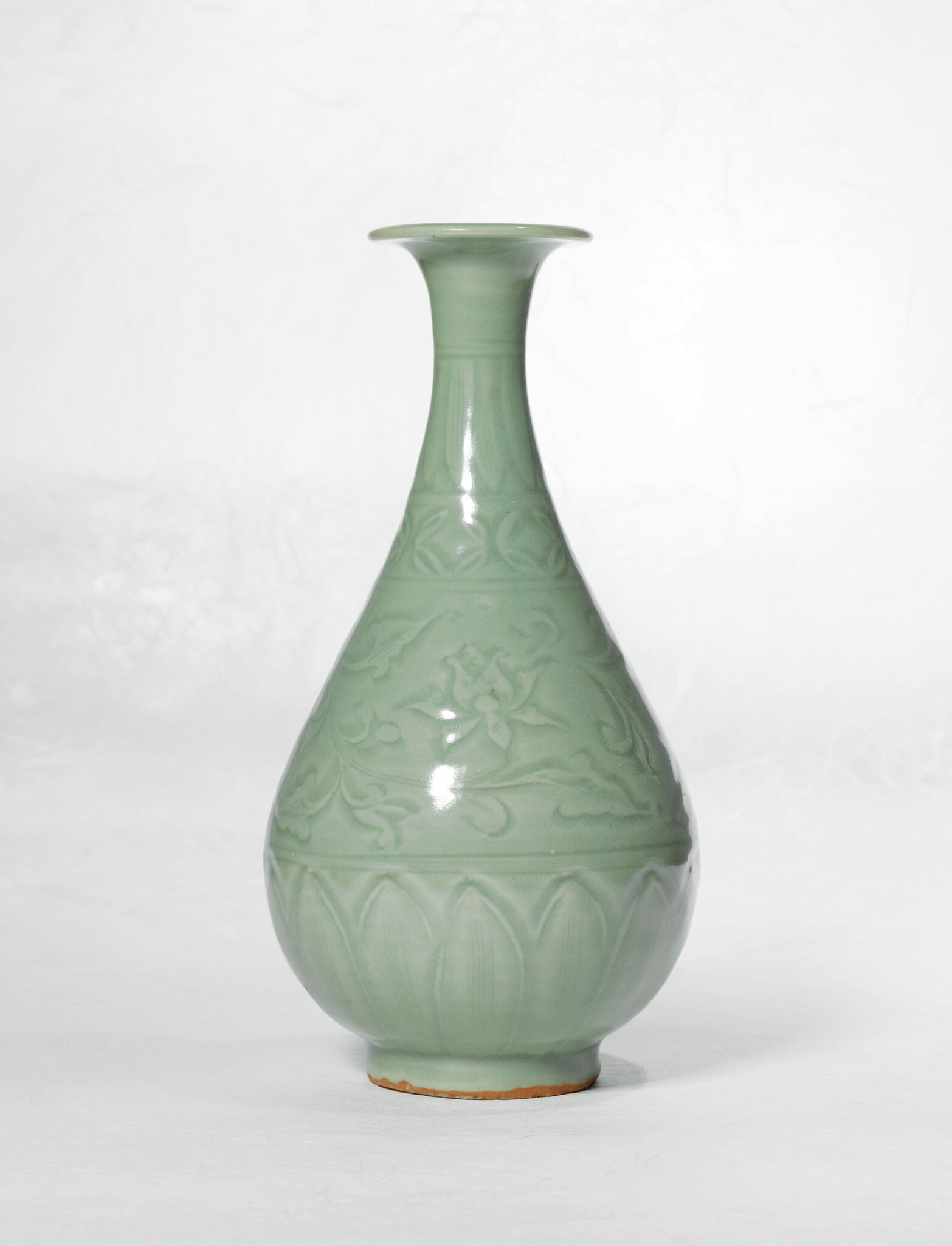 A fine carved 'Longquan' celadon vase (yuhuchun ping), Yuan dynasty