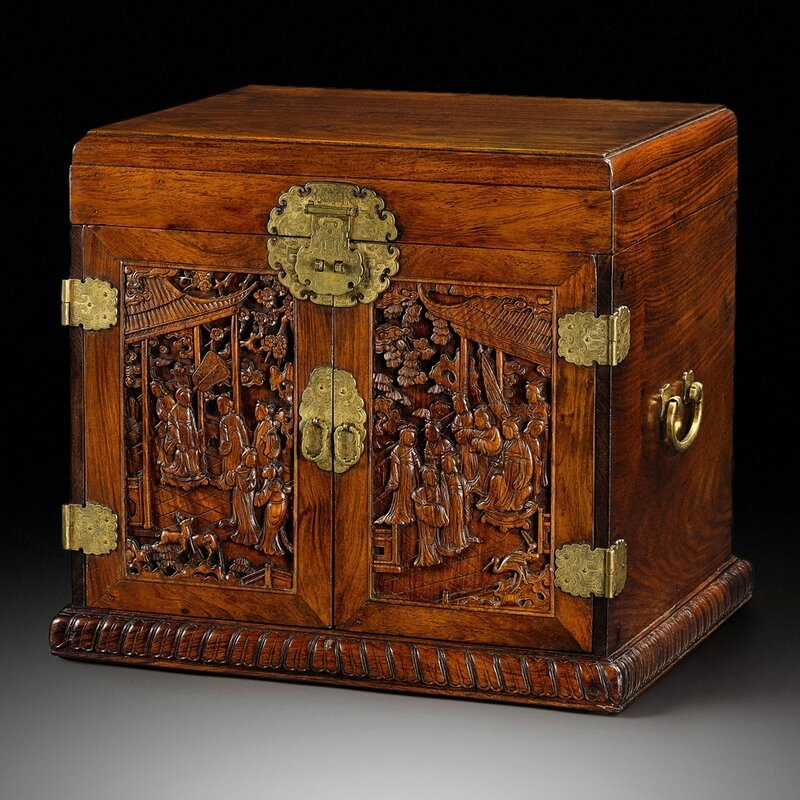 A 'Huanghuali' dressing case with carved doors and gilt-bronze fittings, Late Ming – Early Qing dynasty