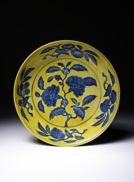 Porcelain dish painted in underglaze blue with yellow glaze, China, Ming dynasty, Zhengde reign period and mark (1506-21)