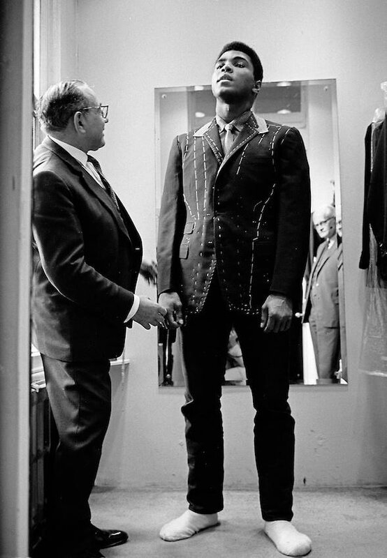 Muhammad Ali is measured for a suit in Savile Row, 1966 • Thomas Hoepker