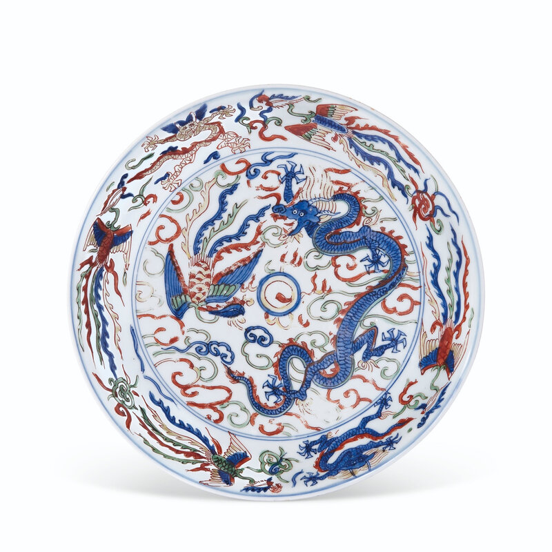 A rare wucai 'Dragon and Phoenix' dish, Wanli six-character mark in underglaze blue within a double circle and of the period (1573-1619)