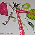 Bijou de sac porte clés grigri vert pomme rose fushia kokeshi