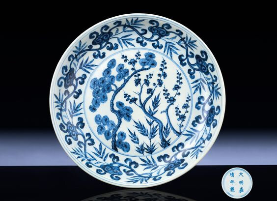 A fine and extremely rare Ming blue and white 'Three friends' dish, Jiajing six-character mark within double-circles and of the period (1522-1566)
