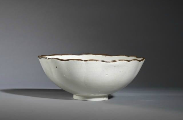 A large Dingyao carved 'mallow' bowl, Northern Song Dynasty