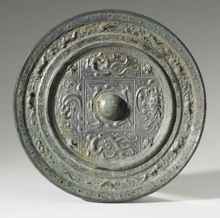 A LARGE BRONZE INSCRIBED 'ZODIAC' MIRROR SUI DYNASTY