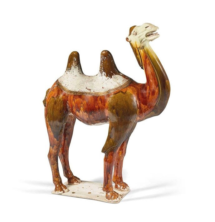 A Chinese sancai-glazed pottery figure of a camel, Tang dynasty (618-907)
