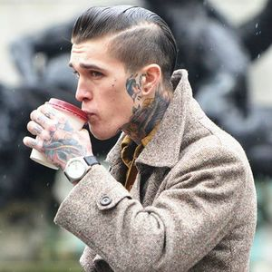 model tattoos neck face side coffee
