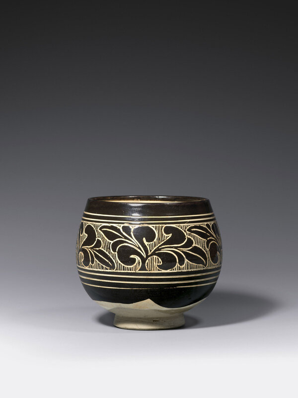 A carved 'black- and white'-glazed Cizhou stoneware bowl, Northern Song Dynasty (A