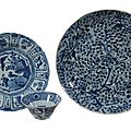 A small chinese blue and white kraak dish, wanli period (1573-1619) and a chinese blue and white dish, kangxi