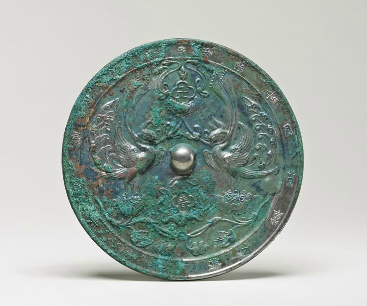 A rare bronze 'Double Phoenix' mirror with inscription, Tang dynasty