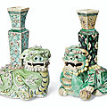 Two biscuit-glazed buddhist lion vases, kangxi period (1662-1722)