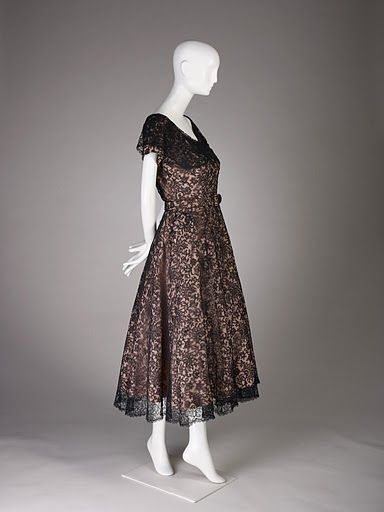 Cristobal Balenciaga. Cocktail dress of rose peau de soie and black lace, winter 1948. Fine Arts Museums of San Francisco, gift of Mrs. C. H. Russell. Photo by Joe McDonald/Fine Arts Museums of San Francisco