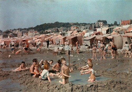 Children play in pool they have dug out of the sand on the beach in Le Havre, France, 1936