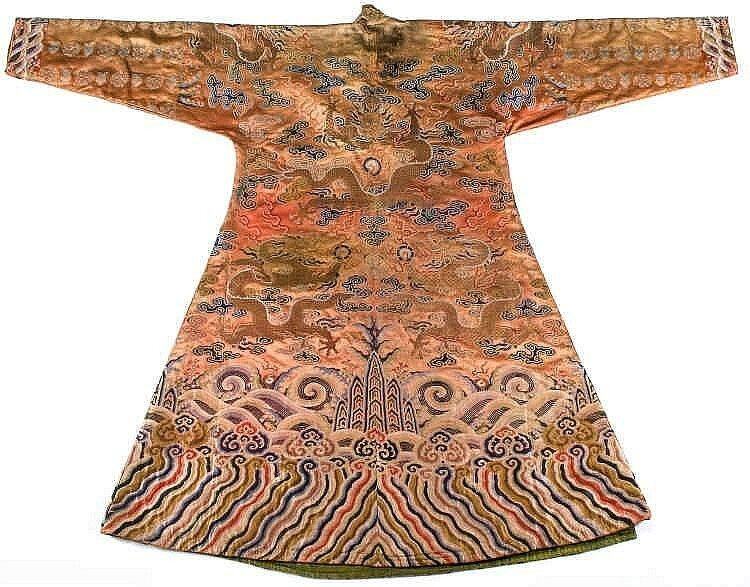 A coral ground silk Tibetan chuba, tailored from 18th century Chinese kesi2