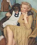1952_MonkeyBusiness_Dressed_YellowDress_OnSet_withMonkey_010