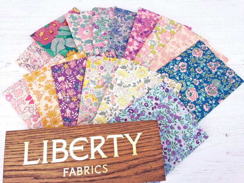 Alice Caroline Exclusives with LIberty sign