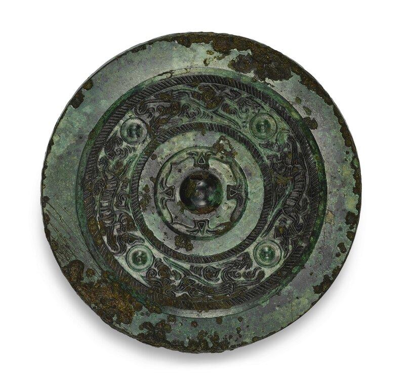 A bronze 'dragon and tiger' mirror, Han dynasty