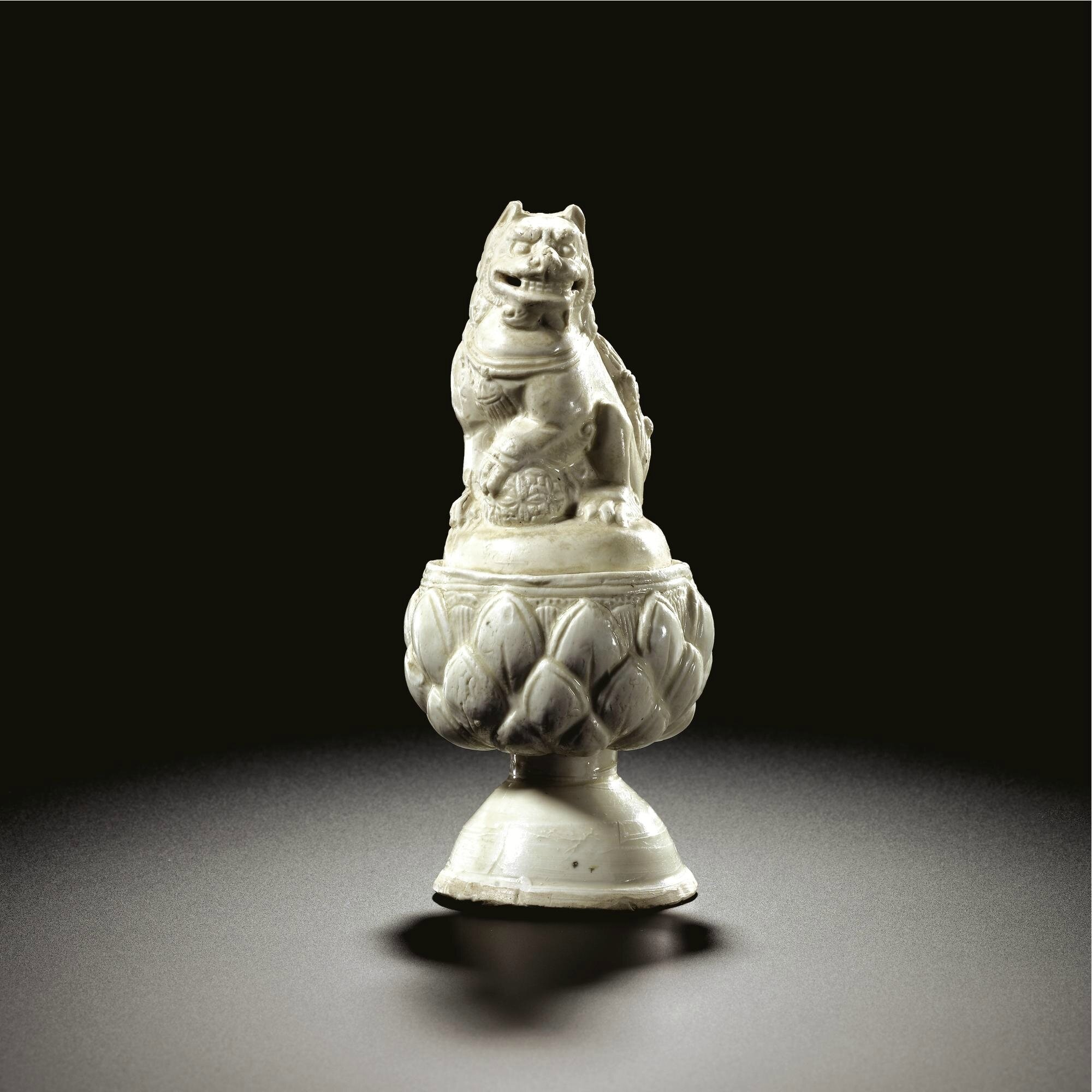 A rare white-glazed 'Lion' incense burner and a cover, Tang dynasty