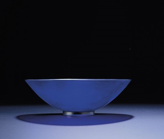 A rare imperial transparent sapphire-blue glass conical bowl, Qianlong incised four-character mark within a square and of the period (1736-1795)