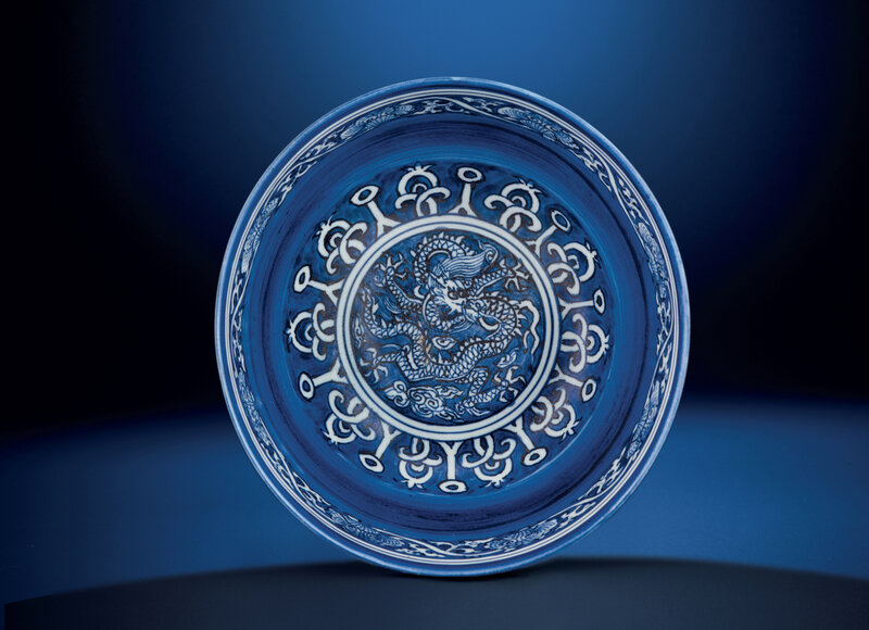 A fine and very rare blue and white reverse-decorated 'dragon' bowl, Jiajing six-character mark and of the period (1522-1566)