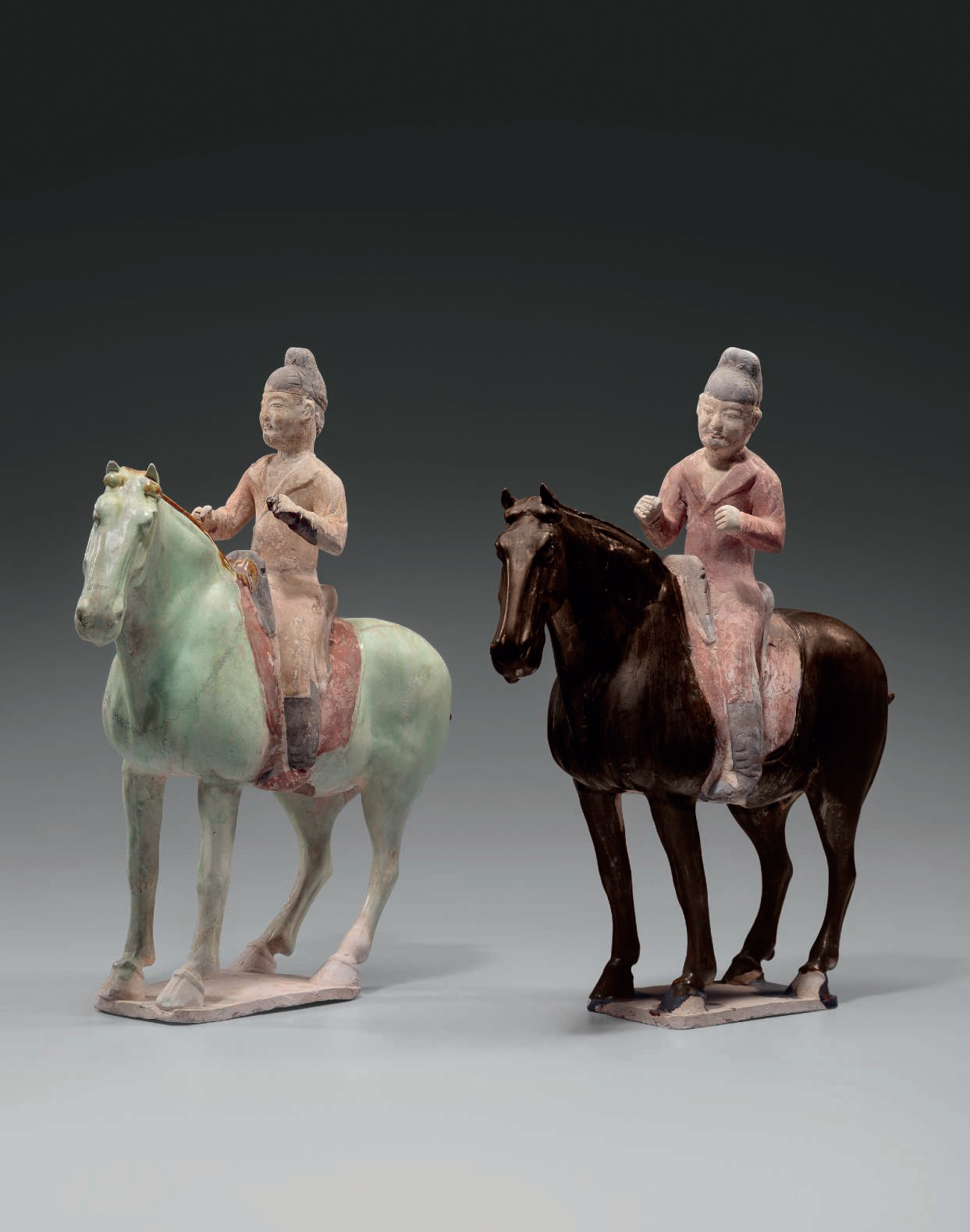 Two rare glazed and painted pottery figures of equestrians, Tang dynasty (AD 618-907)