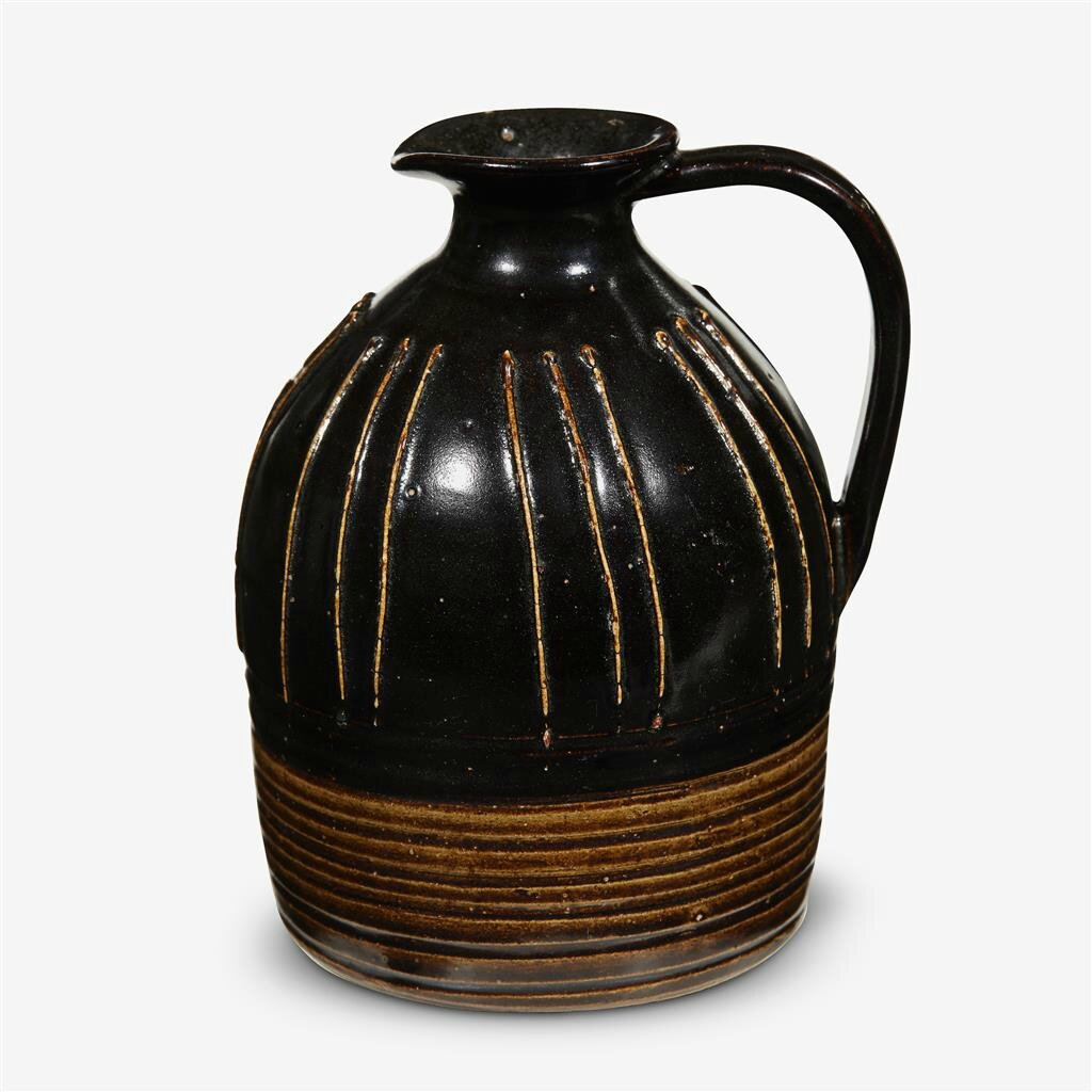 A Chinese 'Cizhou' black glazed ribbed ewer, Northern Song dynasty (960–1127)