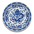A fine and rare large blue and white 'dragon' dish, qianlong seal mark and period (1736-1795)