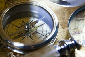 13503147-old-navigation-instrument-map-and-compass