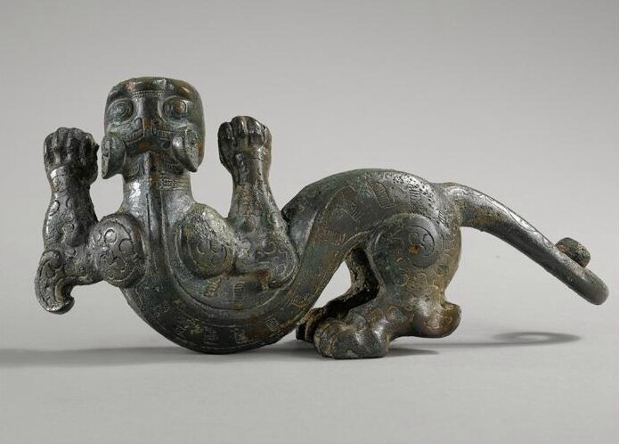 A rare cast bronze fitting in the form of a tiger, Eastern Zhou Dynasty, Warring States period