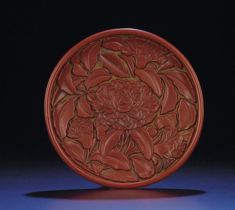 A rare small carved cinnabar lacquer 'peony' dish, Yuan dynasty (1279-1368)