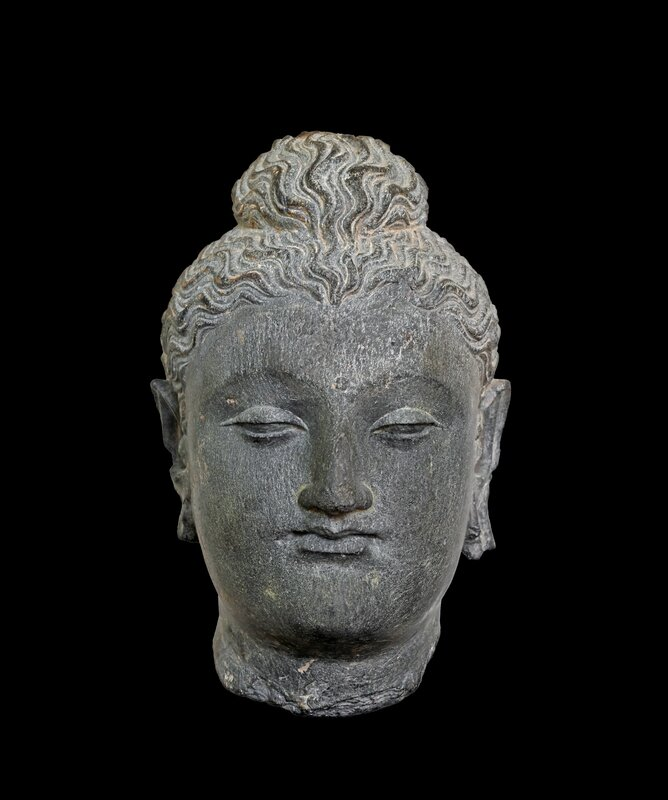 Gandhara head of Buddha in grey schist