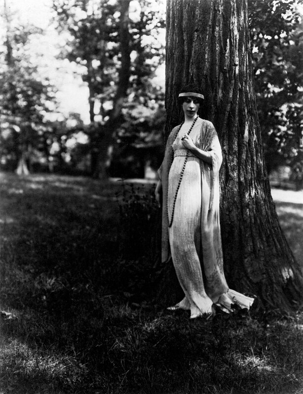 Clarisse Coudert, wife of Condé Nast, in a Fortuny Delphos and long mantle, c