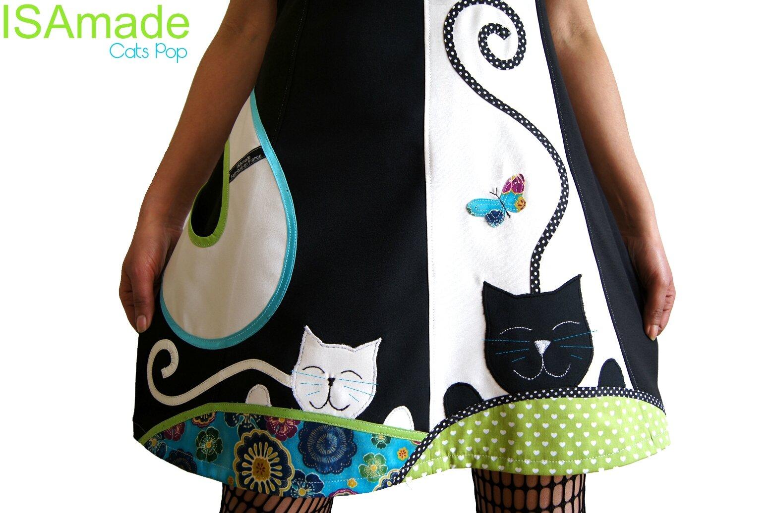 Une robe Femme maille Noire et Blanc cassé Bicolore à application patch Imprimé Coeurs vert anis et imprimé Fleurs Turquoise Violet