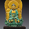 A dated sancai-glazed stoneware figure of Buddha, dated to mid-autumn of the yimao year of Jiajing, corresponding to 1555, and of the period