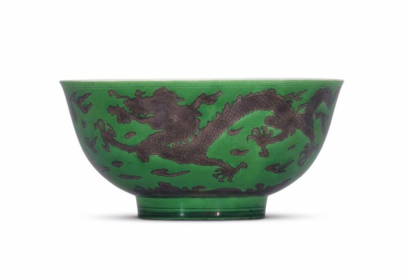 A fine incised green-ground aubergine-enamelled 'dragon' bowl, Kangxi six-character mark in underglaze blue within a double circle and of the period (1662-1722)