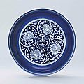 A reserve-decorated blue and white 'longevity' dish, Jiajing six-character mark in