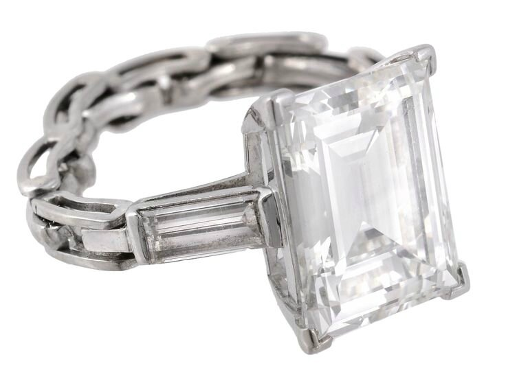 A diamond single stone ring, the rectangular step cut diamond