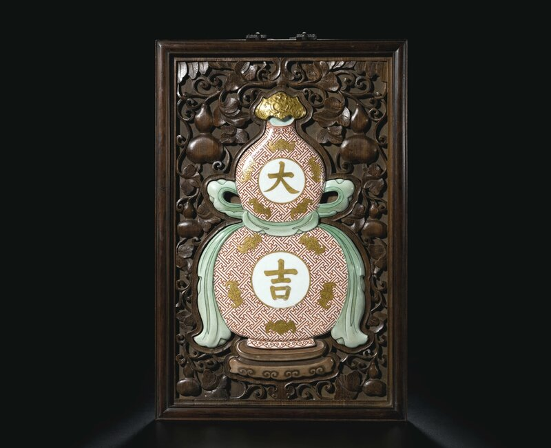 A famille-rose 'daji' double-gourd plaque, Qing dynasty, 18th century