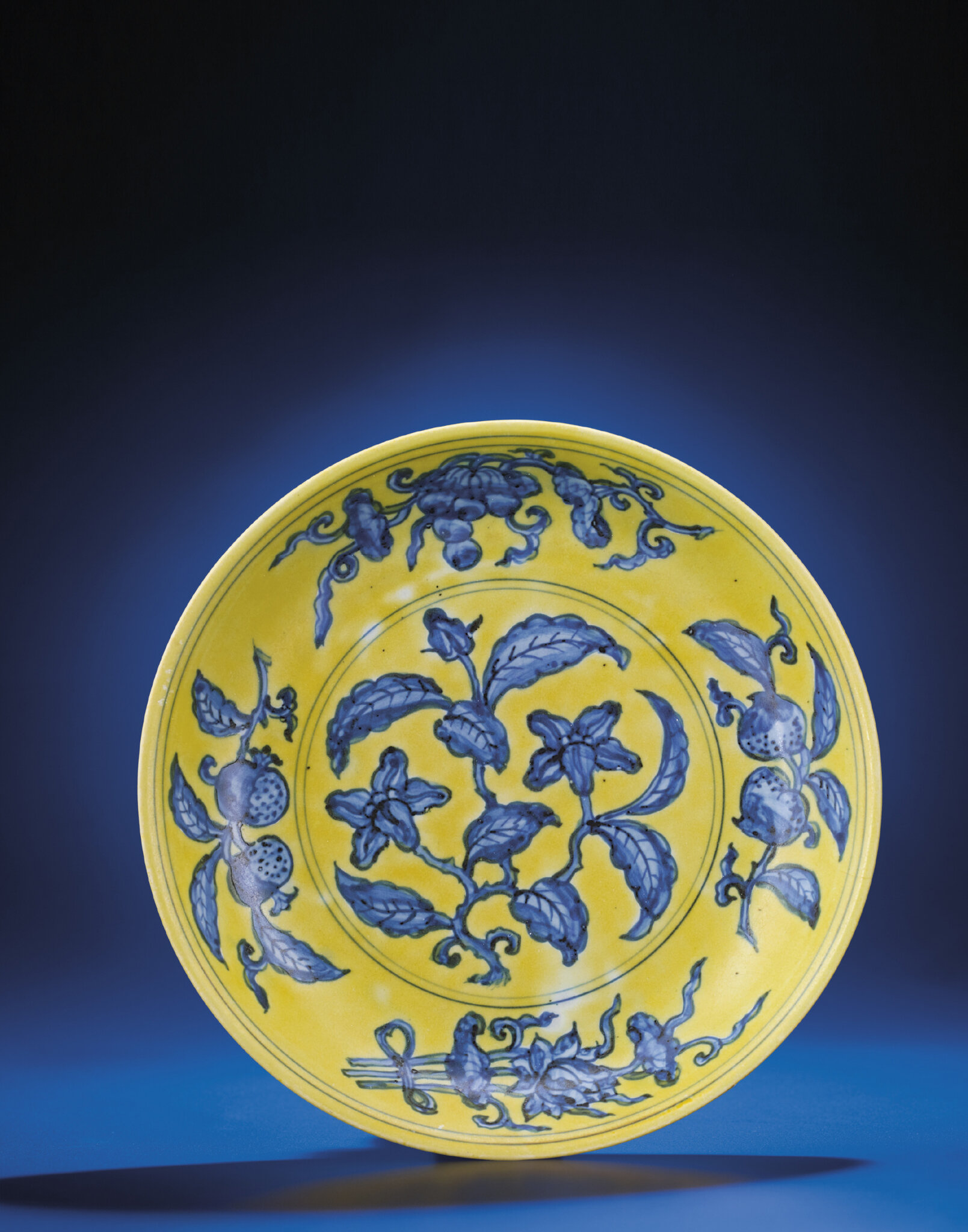 An imperial yellow-ground blue and white dish, Zhengde six-character mark within double-circles and of the period (1506-1521)