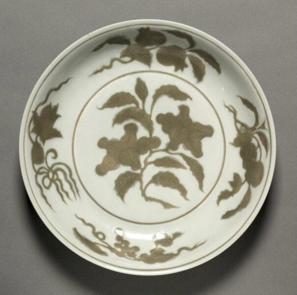 Dish with Flowers and Fruit, 1488-1505, China, Jiangxi province, Jingdezhen kilns, Ming dynasty (1368-1644), Hongzhi mark and reign (1488-1505), porcelain with incised and underglaze coffee brown (iron oxide) decoration, Diameter - w:25.80 cm (w:10 1/8 inc