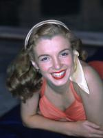 1946-04-04-pool_sitting-swimsuit_red-011-1-by_richard_c_miller-1