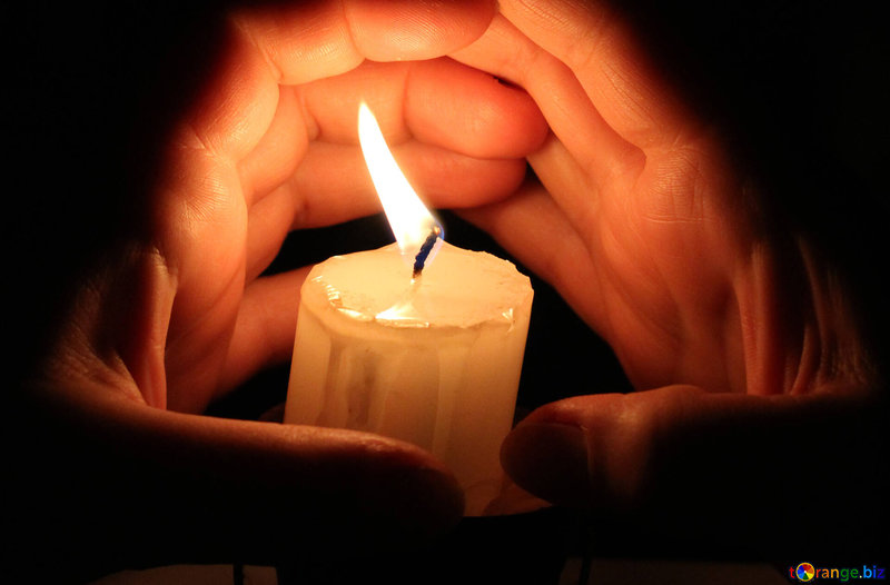 candle-burning-hand-hands-around-candles-18098