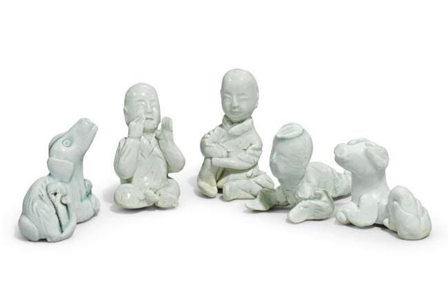 Lot 43. A group of five small Qingbai figures, Song Dynasty (960-1279); the largest: 5.7cm, 2 1/4 in. Estimate 3,000—5,000 GBP. Lot Sold 3,750 GBP. Photo Sotheby's 2011