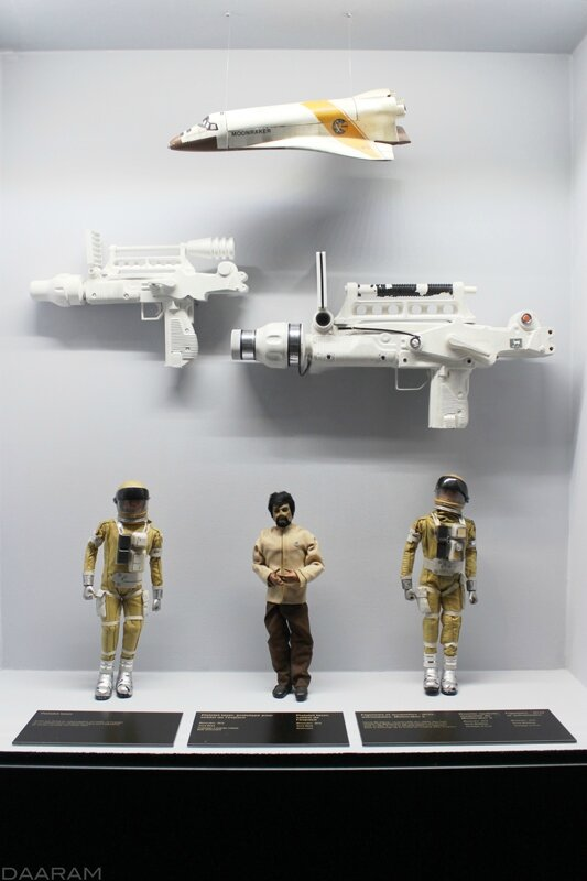 Different figurines, James Bond (Roger Moore) and Drax (Michael Lonsdale), prototypes of laser rifles and a scale model of a space shuttle. «Moonraker» 1979. Photo: Olivier Daaram Jollant © 2016
