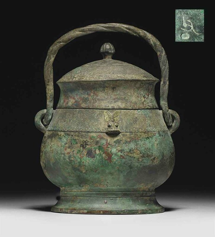A bronze ritual wine vessel and cover,you, Late Shang dynasty, 11th century BC