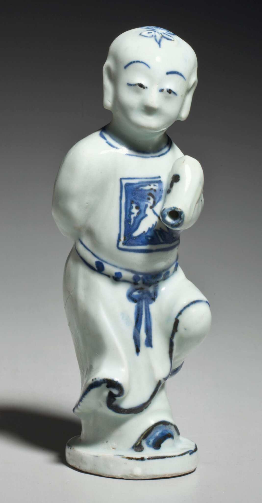 An unusual blue and white boy-form waterdropper, Wanli period (1573-1619)