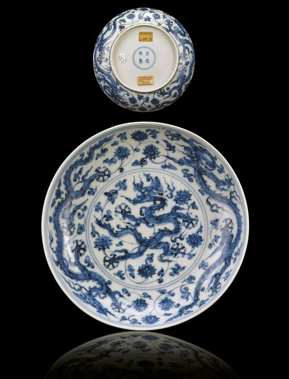 A fine and rare Ming blue and white 'dragon' dish, Zhengde four-character mark within double-circles and of the period (1505-1521)